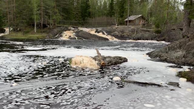 Waterfall at high water time in Karelia, Russia