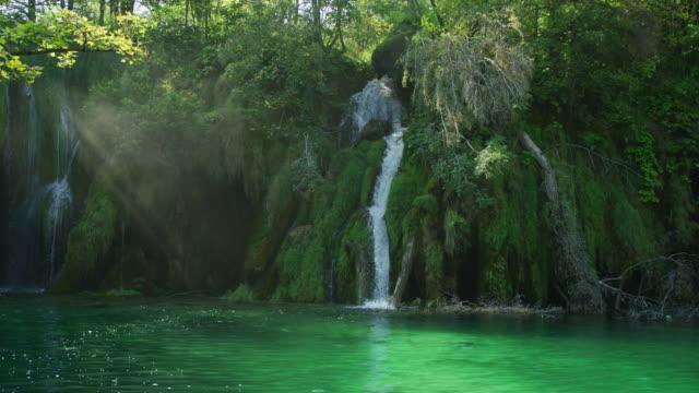 Waterfall falling into lake