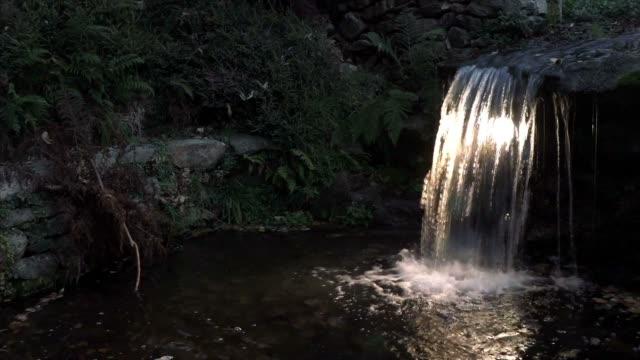 waterfall in the garden - элемент здания стоковые видео и кадры b-roll