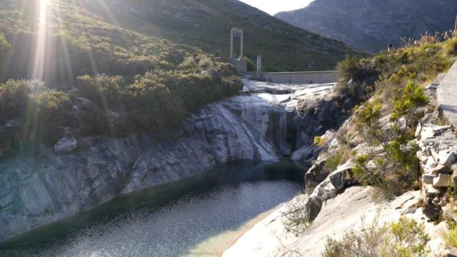 vídeos de stock e filmes b-roll de waterfall most amazing lagoons dam in geres national park, portugal - vídeos de barragem portugal