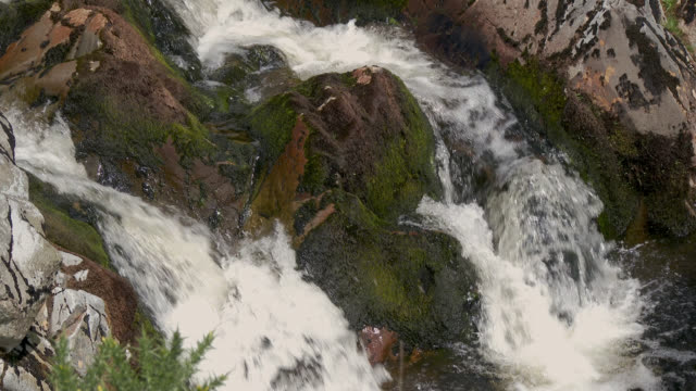 Waterfall on a small Scottish river on a summer afternoon Video shot at 50 fps and interpreted at 25 fps to give slow motion galloway scotland stock videos & royalty-free footage