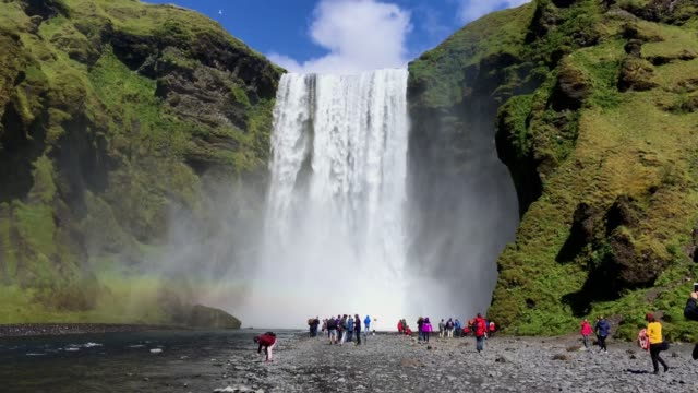 Waterfall Skogafoss under bright blue sky, Iceland