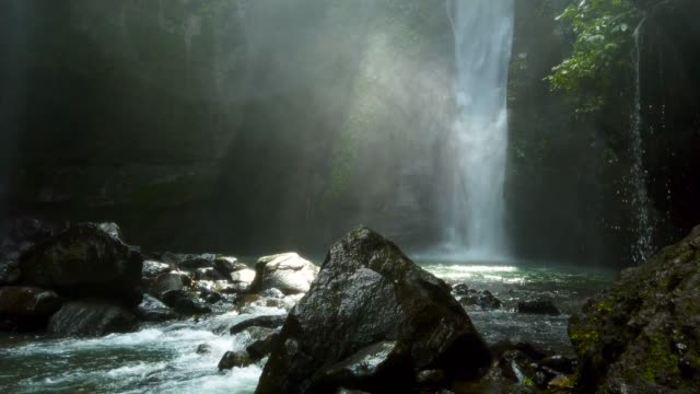 waterfall splashing down rocks - trees in mist stock videos & royalty-free footage