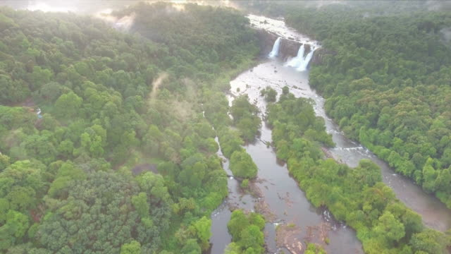 Waterfall Surrounded By Lush Green Forest Aerial View video