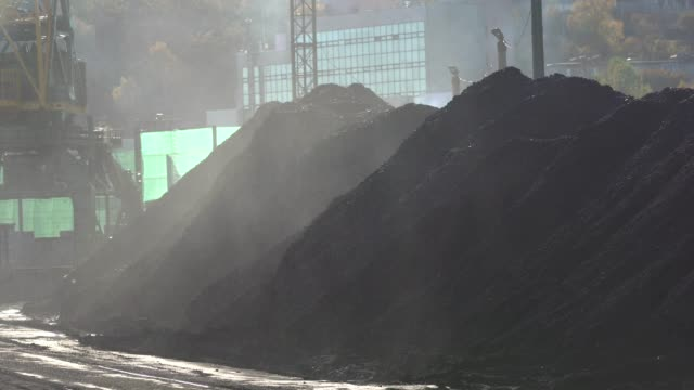 Watering coal heaps with water. The collapses are sprayed with water cannons in the coal port of Nakhodka.