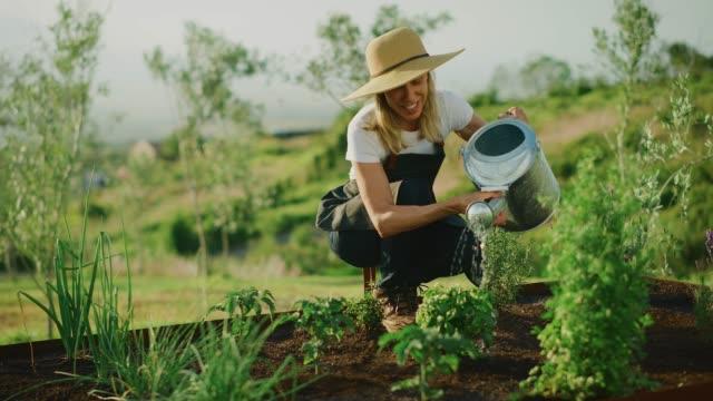 Watering her garden