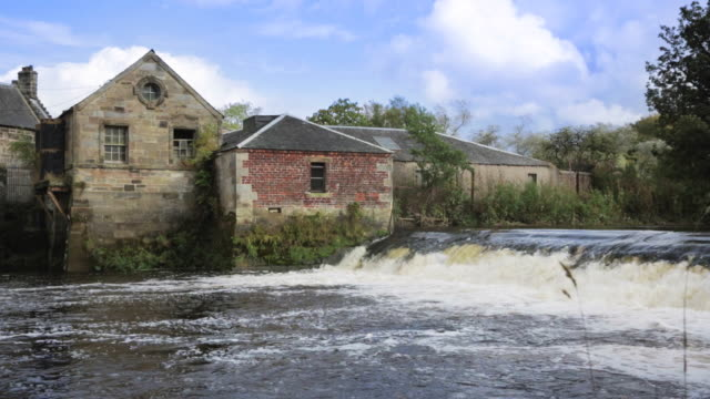 Water-powered Sawmill A Victorian water-powered sawmill on the White Cart Water in Pollock Park, Glasgow, Scotland. 19th century style stock videos & royalty-free footage
