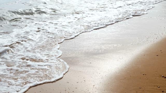 wave breaking på sand beach - beach bildbanksvideor och videomaterial från bakom kulisserna
