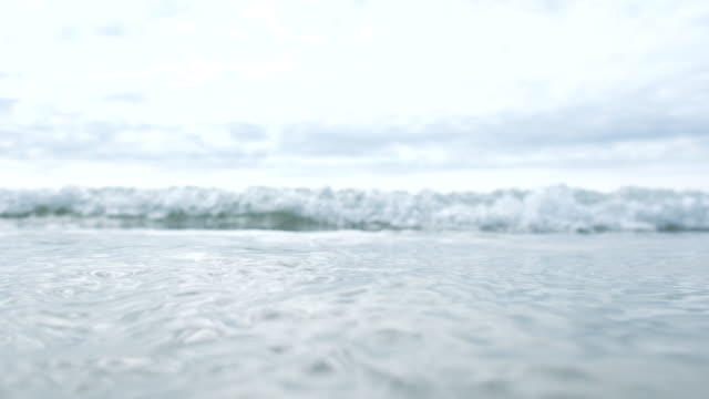 wave breaking towards camera and over the top of the camera, Fistral beach, Cornwall, 5 X slow-motion. video