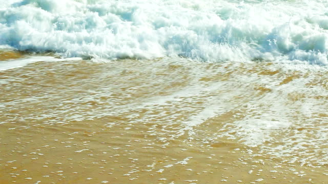 Wave on the sandy beach. video