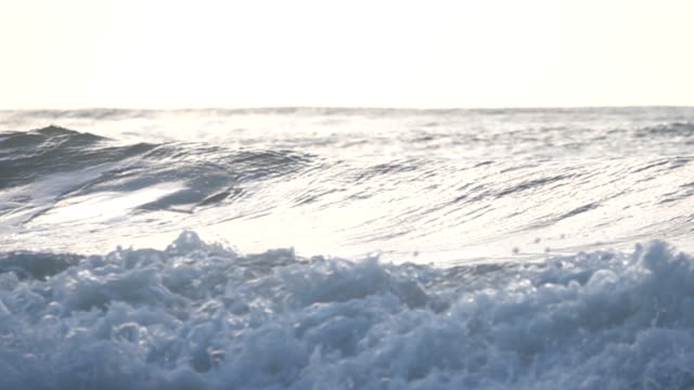 SLOW MOTION: wave over sea