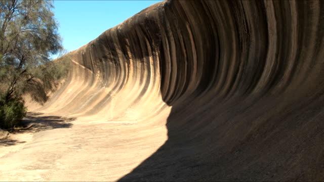 wave rock west australia tilt up - western australia stock videos & royalty-free footage