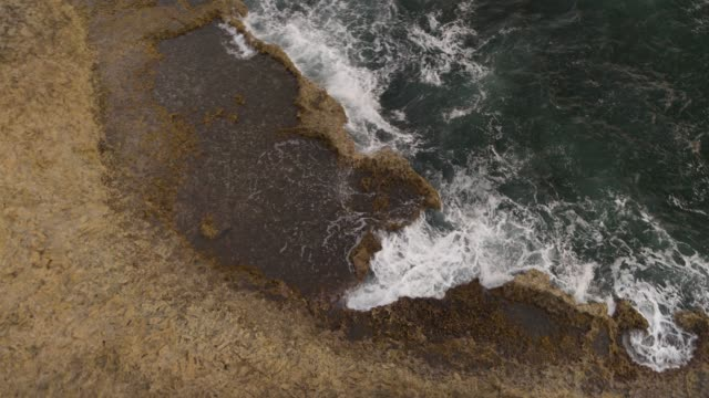 Waves crashing along a rocky beach on Curaçao Details of ocean elements of Curaçao curaçao stock videos & royalty-free footage