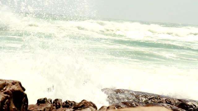 Waves crushing over rocks video