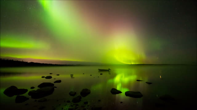 Waves of Colorful Aurora Borealis Rolling Over A Lake video