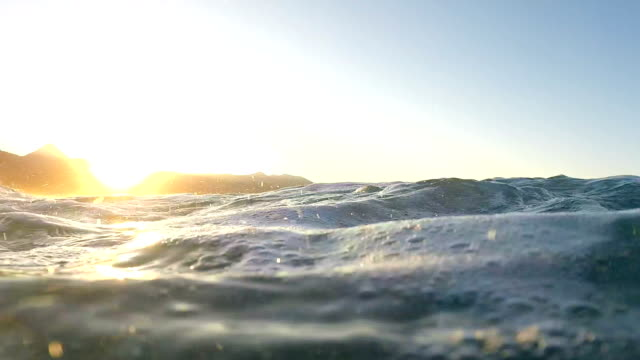 Waves on a beach at sunset video