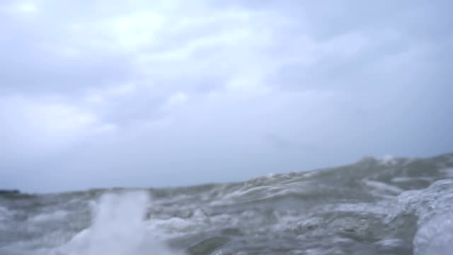 Waves on the ocean. The camera goes under water. video