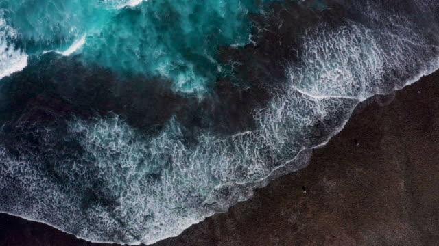 Waves splashing along the coastline in Bali