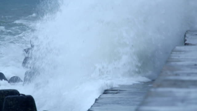 Waves splashing and gale force wind gusts harbor pier video