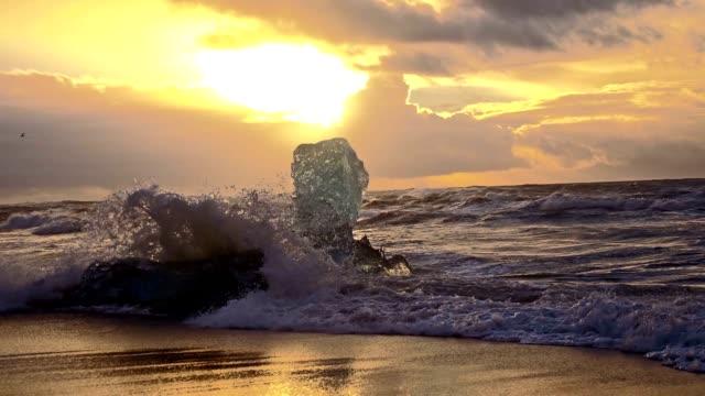SLO MO Waves splashing iceberg on the beach video
