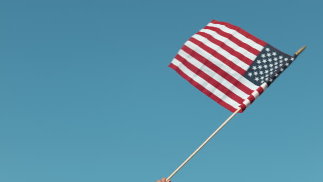 Waving American flag in slow motion video