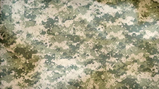 Waving camo green fabric background. Camouflage seamless pattern, military background. camouflage clothing stock videos & royalty-free footage