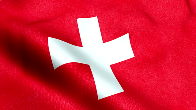 waving fabric texture of the flag of switzerland, red background and white cross