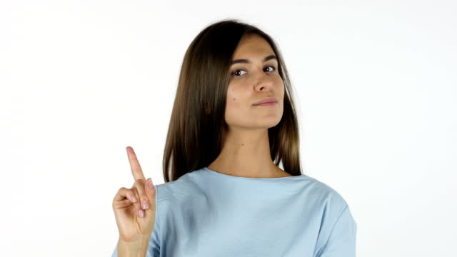 Waving Finger, No, Denying Beautiful Girl, White Background in Studio video
