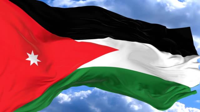 vídeos de stock, filmes e b-roll de agitando a bandeira contra o céu azul jordan - insígnia