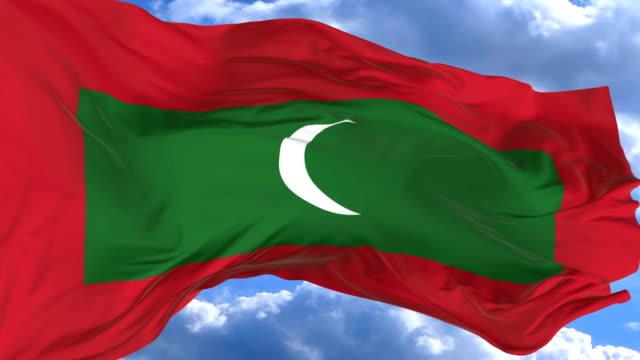 waving flag gainst the blue sky maldives - insygnia filmów i materiałów b-roll