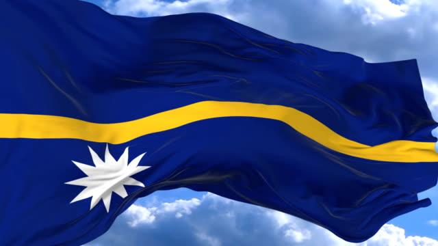 waving flag gainst the blue sky nauru - insygnia filmów i materiałów b-roll