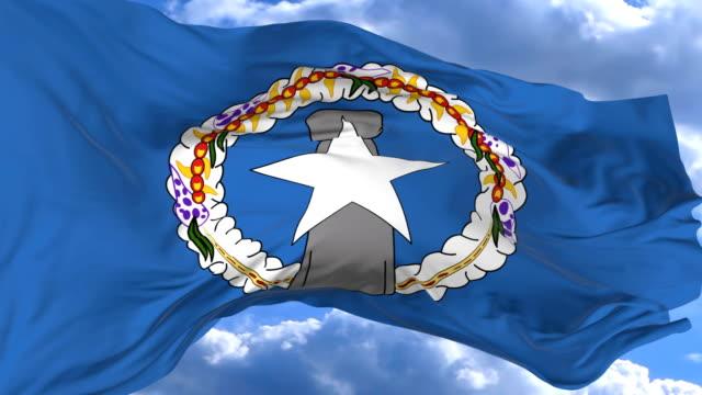 vídeos y material grabado en eventos de stock de ondeando la bandera contra el cielo azul islas marianas del norte - micronesia