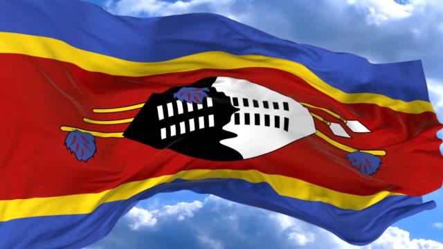waving flag gainst the blue sky swaziland - insygnia filmów i materiałów b-roll