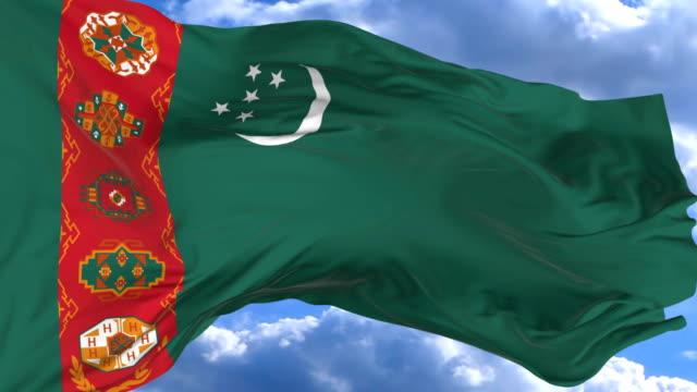 waving flag gainst the blue sky Turkmenistan flag waving in the wind against the blue sky Turkmenistan turkmenistan stock videos & royalty-free footage