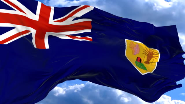 waving flag gainst the blue sky Turks and Caicos Islands flag waving in the wind against the blue sky Turks and Caicos Islands turks and caicos islands stock videos & royalty-free footage