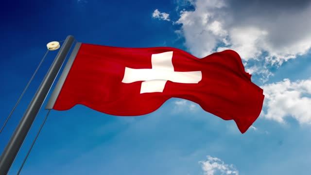 machając flagą szwajcarii - szwajcaria filmów i materiałów b-roll