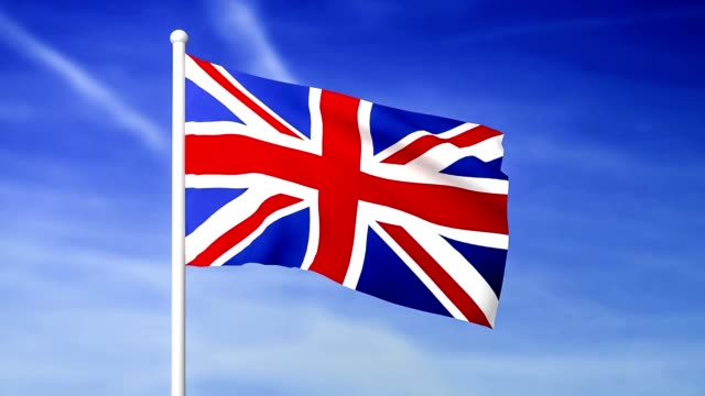 Waving flag of United Kingdom on the blue sky background video
