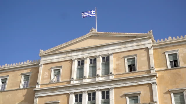 waving flag on the Greek parliament building in Athens, Greece video