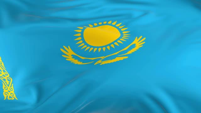 vídeos de stock, filmes e b-roll de acenar em loop bandeira como fundo do cazaquistão - insígnia