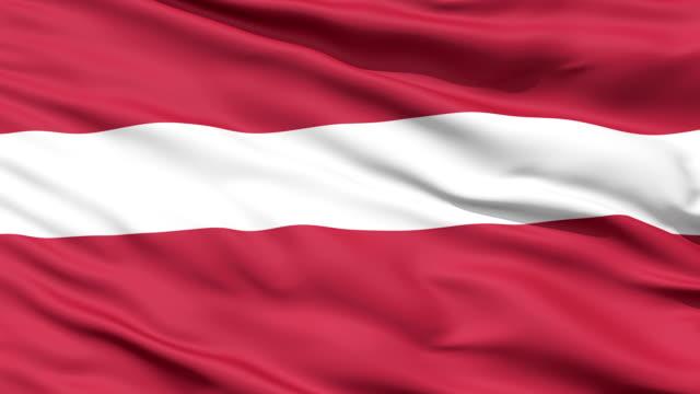 sventolando bandiera nazionale di lettonia - lettonia video stock e b–roll