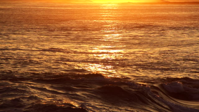 Waving sea at sunrise Waving sea at sunrise. Shot in super slow motion. water's edge stock videos & royalty-free footage