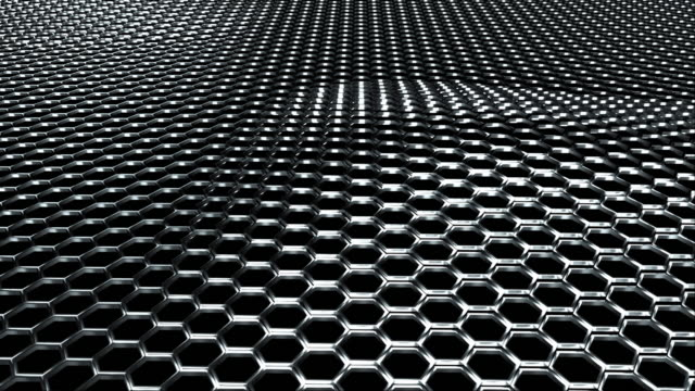wavy metal net made of shiny silver hexagons. computer generated modern background, 3d rendering - esagono video stock e b–roll