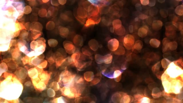 Wavy Moving Bokeh with Brownish Red Colors - 4K Seamless Loop Motion Background Animation This seamless looping motion background video can be extended to play for any duration in any video editor. sepia toned stock videos & royalty-free footage