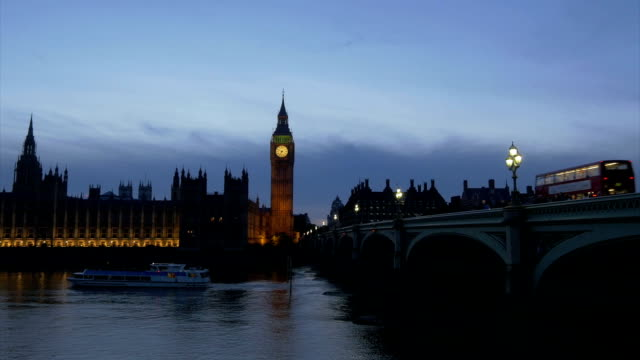 wb_79 MS House of Parliament and Westminster Bridge with Tourist Boat and Bus at Night victorian architecture stock videos & royalty-free footage