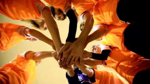 We can do this Together Slow motion Video of Group of female volleyball players and their male coach stacking hands,directly below competition stock videos & royalty-free footage