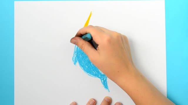 We draw a dolphin. Monodon monoceros.The child draws the picture. video
