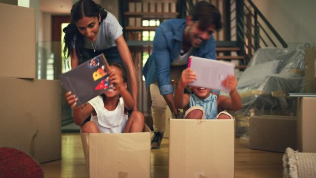 vídeos de stock e filmes b-roll de we grab any opportunity to bring joy to our kids - cardboard box