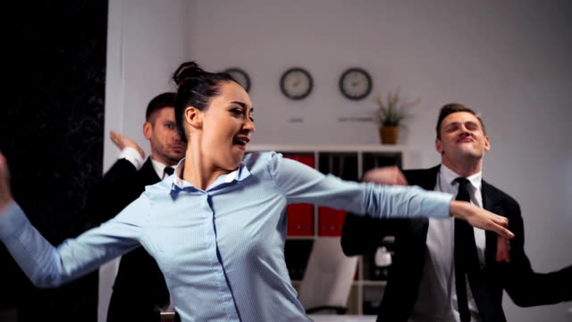 we happy of friday ending businesspeople dancing cheerfully in office in front of the camera - collega d'ufficio video stock e b–roll