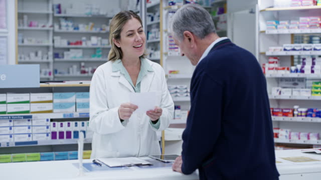 We have your refill on the system 4k video footage of a young pharmacist helping a senior man in a pharmacy pharmacist stock videos & royalty-free footage