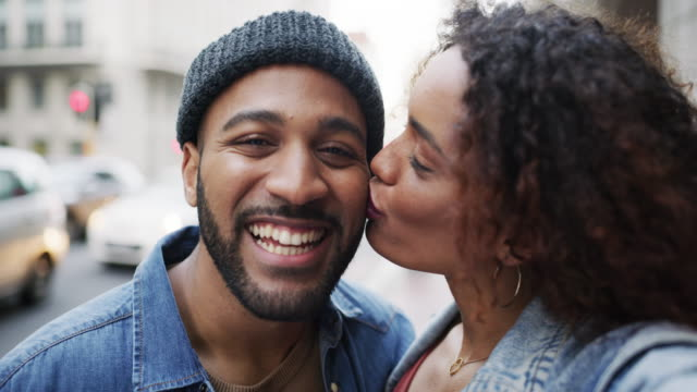 We just love spending our days together 4k video footage of an affectionate young couple taking a selfie while enjoying themselves out in the city kissing stock videos & royalty-free footage